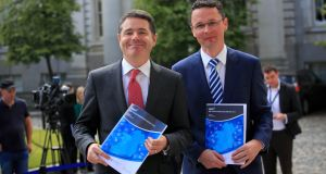 Minister for Finance Paschal Donohoe and Minister of State Patrick O'Donovan at a press briefing on Thursday around a mid-year expenditure report from the Department of Finance. Photograph: Gareth Chaney Collins