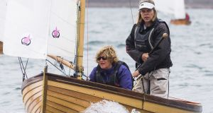 Cathy MacAleavey (standing)  with Judith Malcolm in Mollie, a Water Wag dinghy at the Volvo Dún Laoghaire Regatta 2017 recently.  Photograph: David Branigan/Oceansport