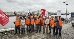 Striking crane drivers  on Sir John Rogerson's Quay, Dublin, last month. Photograph: Brenda Fitzsimons
