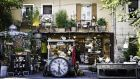 One of the many antique shops in the bustling town of L'Isle-sur-la-Sorgue, which holds Europe's largest flea market twice a year. Photograph: Getty Images