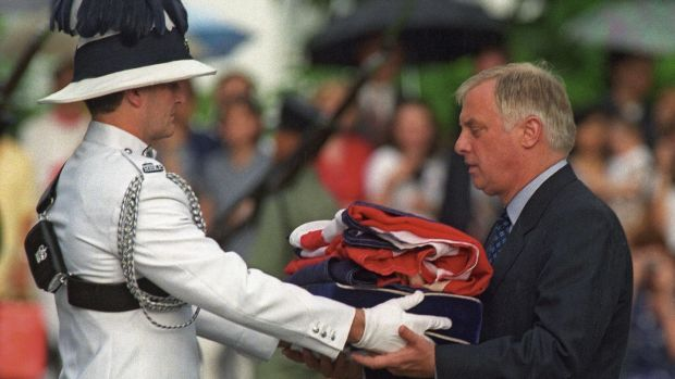 Last governor: Chris Patten receives the Union Jack after it was lowered over Hong Kong for the final time, on June 30th, 1997. Photograph: Emmanuel Dunand/AFP/Getty