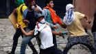 Police and protesters clash as Venezuelans hold anti-Maduro strike