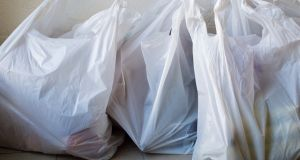 Average shopper in England now takes home about 25 bags a year from supermarkets. Photograph: iStock