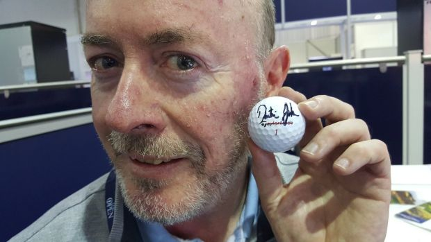 Philip Reid with the golf ball he was hit by, signed by Dustin Johnson.