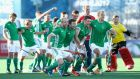 The Ireland team celebrate winning their  penalty shootout during the 5th-8th place play-off against France. Photograph: Jan Kruger/Getty Images for FIH