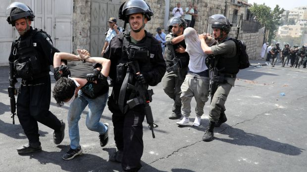 Israeli security forces arrest Palestinian men following clashes outside Jerusalem's Old City. Photograph: Ammar Awad/Reuters