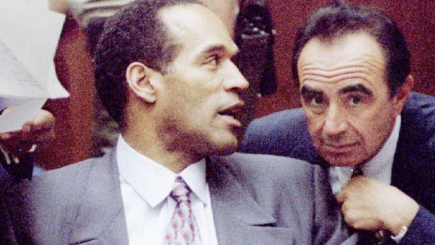 Simpson confers with his attorney Robert Shapiro in the 1994 murder trial. Photograph: Vince Bucci/Reuters