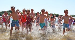 WATER SAFETY: Sunshine equals funshine!  Children taking water safety classes at Annagh Lake, Butlersbridge, Co Cavan, take a break to enjoy splashing and cooling off during a spot of hot weather. Photograph: Lorraine Teevan