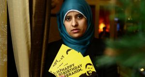 Somaia Halawa with a postcard of her brother: Ibrahim Halawa has been  held in Egypt for almost four years. Photograph: Cyril Byrne / The Irish Times
