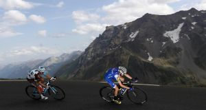 """It might sometimes looks like myself and Romain bardet are racing together as we take turns to attack."" Photograph: Bryn Lennon/Getty Images"