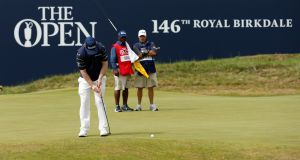 South Africa's Branden Grace holes  his par putt on the 18th green at Royal Birkdale to complete a third round  of 62 at the British Open, the lowest score in a men's Major Championship. Photograph:   Andrew Boyers/Reuters