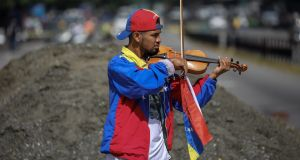Violinist Wuilly Arteaga participates in a demonstration in Caracas, Venezuela, on July 18th. Photograph: EPA/Miguel Gutiérrez