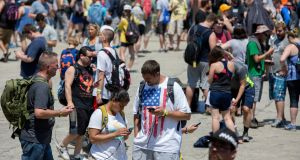 Festival goers wander the grounds at the Pokemon Go Fest Saturday in Chicago. Photograph: AP