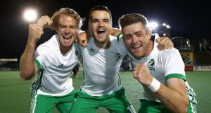 Goalscorer  Alan Sothern (centre) celebrates the win over New Zealand and World Cup qualification with his Ireland team-mates Stuart Loughrey (left) and Shane O'Donoghue in Johannesburg. Photograph:   Jan Kruger/Getty Images for FIH
