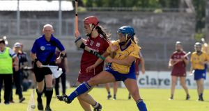 Clare's Roisin McMahon challenges  Orlaith McGrath of Galway during the Liberty Insurance All-Ireland Senior Camogie Championship game at Cusack Park in Ennis. Photograph: Donall Farmer/Inpho