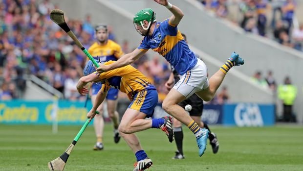 Clare's Podge Collins with Noel McGrath of Tipperary. Photograph: Morgan Treacy/Inpho