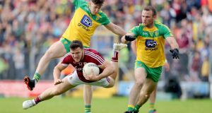 Galway's Damien Comer comes under pressure from  Donegal players Neil McGee and Kieran Gillespie at Markievicz Park. Photograph: Tommy Dickson/Inpho
