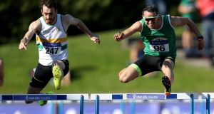 Thomas Barr on his way to winning the 400m hurdles title on Sunday in Santry. Photograph: Bryan Keane/Inpho