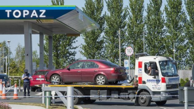 A car in which James 'Mago' Gately was shot earlier this year is removed from a petrol station on Clonshaugh Road in Dublin. Photograph: Brenda Fitzsimons