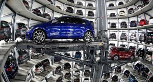 Volkswagen Golfs are loaded in a delivery tower at the plant of German carmaker Volkswagen in Wolfsburg, Germany. Photograph: Reuters