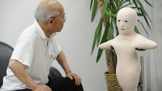"An elderly man communicates with his granddaughter via the new humanoid robot called ""Telenoid R1"": Photograph: Yoshikazu Tsuno/AFP/Getty Images"