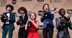Finn Wolfhard, Gaten Matarazzo, Millie Bobby Brown, Noah Schnapp, and Caleb McLaughlin, co-recipients of the Outstanding Performance by an Ensemble in a Drama Series award for 'Stranger Things,' during the 23rd Annual Screen Actors Guild Awards. Photo AFP Photo / Frederic J. Brown, Getty Images