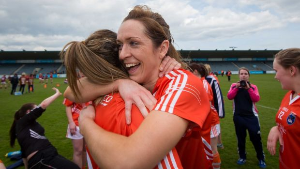 Armagh's Caroline O'Hanlon celebrates with Sharon Reel after winning the league in 2015. Photograph: Ryan Byrne/Inpho