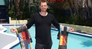 Gerry Kelly with two  pairs of his signature patchwork jeans