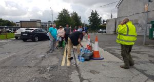 "People filling up containers at a ""temporary water station"" in Ballsgrove, Drogheda. Photograph: Patrick Logue"