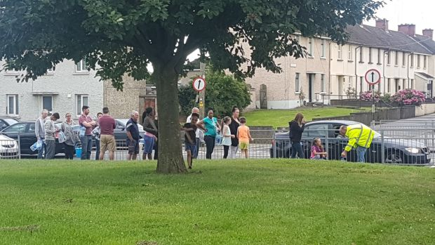 "People queuing at a ""temporary water station"" on Bóthar Brugha, Drogheda. Photograph: Patrick Logue"
