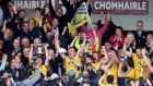 Roscommon celebrate as Niall Kilroy lifts the Nestor Cup following their victory over Galway in the Connacht final at Pearse Stadium. Photograph: Tommy Dickson/Inpho