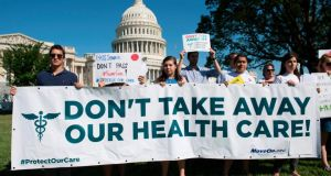 Healthcare protest: a rally outside the US Capitol, in Washington, DC. Photograph: Saul Loeb/AFP/Getty