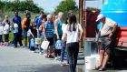 Residents at Termon Abbey in Drogheda queue for water. Photograph: Cyril Byrne