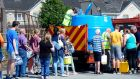 Residents at Turmon Abbey in Drogheda queue for water supplied by Drogheda council following a burst pipe. Photograph: Cyril Byrne / The Irish Times