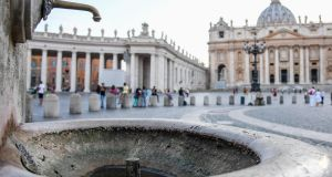 A dry fountains is seen in St Peter's Square at the Vatican. Photograph: Alessandro Di Meo/ANSA via AP