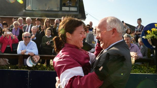 Katie Walsh celebrates with her father Ted after winning the Irish Grand National on Thunder and Roses. Photograph: Cyril Byrne/The Irish Times