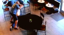 CCTV captures coffee shop customer fighting off knife-wielding robber