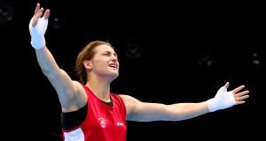 Katie Taylor of Ireland celebrates winning her bout against Sofya Ochigava of Russia. Photograph:  Scott Heavey/Getty Images