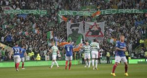 Celtic fans display banners during their Champions League qualifying clash with Linfield. Photo: Getty Images