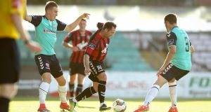 Bohemians' Paddy Kavanagh takes on Derry's Dean Jarvis during their clash at Dalymount Park. Photograph: Ryan Byrne/Inpho