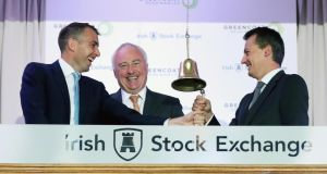 Bertand Gautier  and Paul O'Donnell, partners of Greencoat Capital with   Rónán Murphy, chairman of Greencoat Renewables Plc  at the Irish Stock Exchange. Photograph: Robbie Reynolds