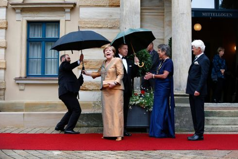 FACING THE MUSIC: German chancellor Angela Merkel as she arrives on the red carpet for the opening of the Wagner opera festival outside the Grüner Hügel opera house in Bayreuth. Photograph: Michaela Rehle/Reuters