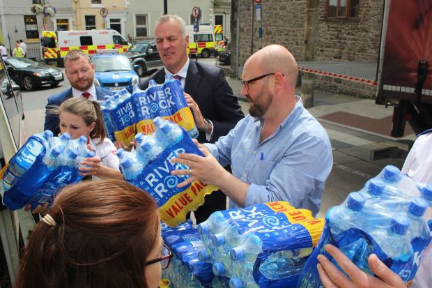 Labour senator Ged Nash and Coca Cola executives David Mulholland (left) and Paul McDonnell filling an Order of Malta ambulance with donated bottles of water in Drogheda. Photograph: Simon Carswell