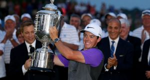 Rory McIlroy holds aloft the US PGA after winning at Valhalla in 2014. Photo: Getty Images