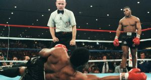 Mike Tyson defeats Trevor Berbick to become the youngest heavyweight champion in the world in November 1986 in Las Vegas.   Photograph: AFP/Getty Images