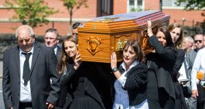 The coffin of Billy McConville, son of IRA murder victim Jean McConville, is taken from St Paul's Parish Church, Belfast following his funeral service. Photograph: Liam McBurney/PA