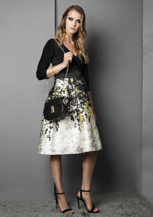 Printed dress with black wrap top, €308, and 100 per cent leather shoulder bag, €179, from Fee G