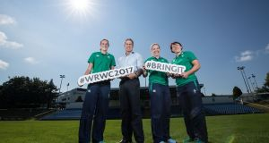 Hannah Tyrrell, Ireland coach Tom Tierney, team  captain Niamh Briggs and Lindsay Peat at the Ireland squad announcement for the Women's Rugby World Cup at UCD. Photograph: Dan Sheridan/Inpho