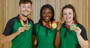 Medalists John Fitzsimons (bronze in the men's 800m)  Gina Akpe-Moses (gold in women's 100m) and Michaela Walsh (bronze in the Hammer) at the homecoming of the Irish team from the European Athletics Under-20 Championships in Italy. Photograph: Sam Barnes/Sportsfile