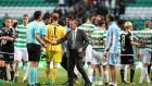 Celtic manager Brendan Rodgers shakes hands with the match officials after the match at Celtic Park. Photograph: PA